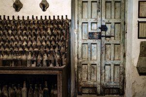 Old sherry bottles in Jerez bodega Spain
